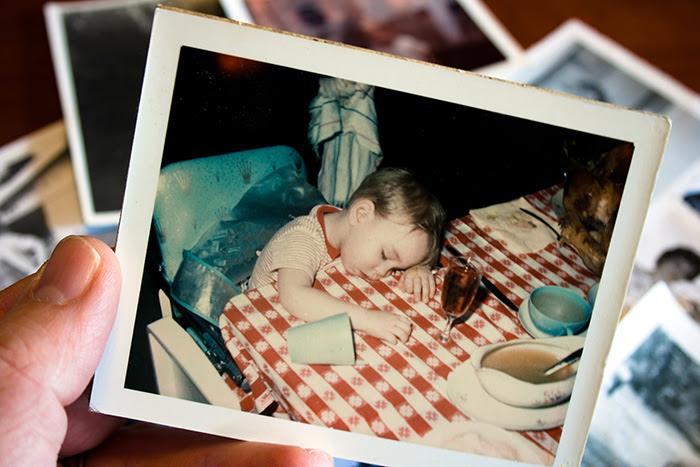 Child sleeping on kitchen table